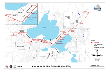 Alternative 2a LPA, Railroad Right-of-Way includes a rail alignment along railroad corridors with stations at Reiner Road/West Sun Prairie (includes Park and Ride), Lein Rd (East Towne Mall), Fair Oaks (includes Park and Ride), Union Corners, Schenck-Atwood, Baldwin St, Paterson St, Hancock St, Monona Terrace, Park St/Kohl Center, Union South, UW Medical Center, Shorewood Hills, Midvale Boulevard, HillFarms/Whitney Way, Downtown Middleton, Highways 12 and 14 (includes Park and Ride), and Greenway Station.